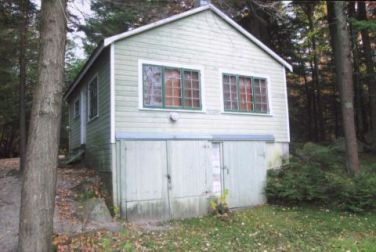 54eb5fab11abb_-_little-house-on-the-lake-before-backyard-0912-xln